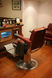 Barbers Chair. Red leather barbers shop chair Stock Photos