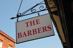 Barbers sign on building Royalty Free Stock Images