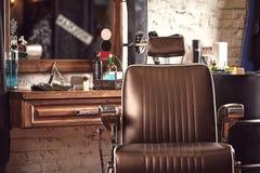 Barbershop armchair. Modern hairdresser and hair salon, barber shop for men.