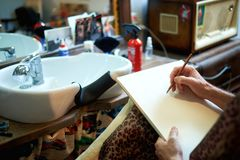 Barbershop of an artist`s hand paint stock image
