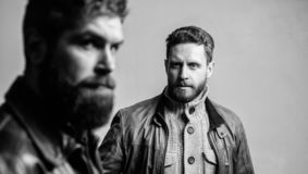 Barbershop concept. Men handsome with beard and mustache facial hair. Barber and beard grooming. Masculine men with well stock photo