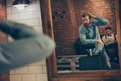 Barbershop concept. Reflection of red bearded harsh stylish man Stock Photos