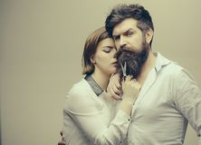 Barbershop or hairdresser concept. Woman hairdresser cuts beard with scissors. Man with long beard, mustache and stylish Royalty Free Stock Photos