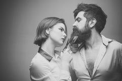 Barbershop or hairdresser concept. Woman hairdresser cuts beard with scissors. Man with long beard, mustache and stylish Royalty Free Stock Images