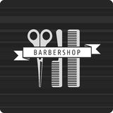 Barbershop logo scissors and two combs Royalty Free Stock Image