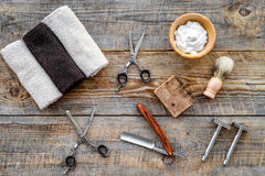 Barbershop. Men`s shaving and haircut. Brush, razor, foam, sciccors on wooden table background top view Royalty Free Stock Photo