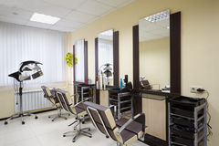 Barbershop room with three working places Royalty Free Stock Images