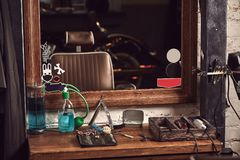 Barbershop tools on wooden brown table. Accessories for shaving and haircuts on the table. Still life royalty free stock images