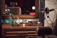 Barbershop tools on wooden brown table. Accessories for shaving and haircuts on the table. Still life stock photo