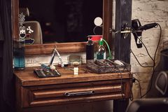 Barbershop tools on wooden brown table. Accessories for shaving and haircuts on the table. Still life stock images