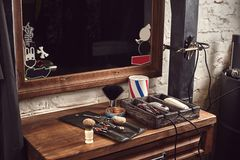 Barbershop tools on wooden brown table. Accessories for shaving and haircuts on the table. Still life stock photos