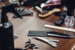 Barbershop tools on wooden table. Accessories for shaving and haircuts. Barbershop tools on wooden brown table. Accessories for shaving and haircuts on the table royalty free stock images