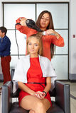 Barbershop. Woman haircut. Use of hair dryer. Royalty Free Stock Photo