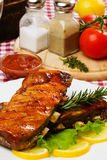 Barbesued ribs with lettuce and lemon slices Stock Photo