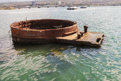 Barbette of gun turret three of the USS Arizona. Emerging from the water. After its sinking, the ship was not salvaged but the main armament was royalty free stock images