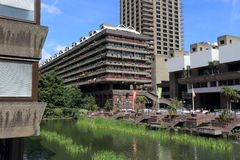 Barbican Estate. LONDON, UK - JULY 6, 2016: Barbican Estate in the City of London. The brutalist style residential estate was built in 1960s and `70s stock photography