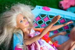 Minsk, Belarus, June 3, 2018: Barbie doll stretches out her hands and wants to be taken into game. royalty free stock images