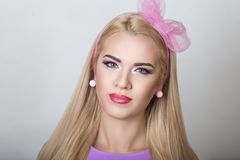 Barbie girl woman. Closeup portrait of beautiful girl woman lady with volume combed hair styling. Luxury blonde golden combed hair. New bright makeup, shiny pink stock photos