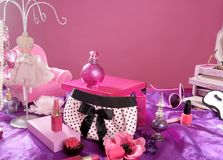 Barbie style fashion makeup vanity dressing table. Pink and purple still photo royalty free stock image