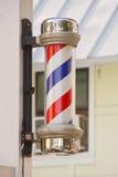 Barbiere classico Palo sull'alberino di legno immagine stock