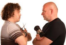 Barbiere due che si leva in piedi faccia a faccia Fotografia Stock