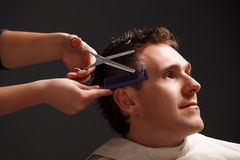 Barbiere e cliente Fotografie Stock