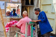 A barbour in Varanasi, India. A local street barbour in Varanasi, India royalty free stock image