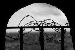 Barbwire around bars on top of the tower Royalty Free Stock Photography
