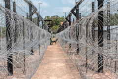 Barbwire fence / border Stock Photos
