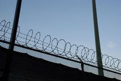 Barbwire fence - danger, border and prison Stock Image