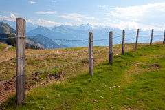 Barbwire fence in the Swiss countryside Stock Photos