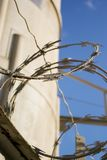Barbwire outside a prison Royalty Free Stock Photo