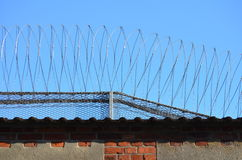 Barbwire on a prison wall Royalty Free Stock Photography