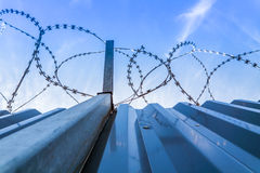 Barbwire protection fence with blue sky Royalty Free Stock Photos