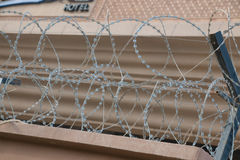 Barbwire securing hotel Stock Photo