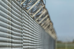 Barbwired Fence Suggesting Illegal Immigration Stock Image