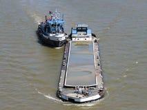 Barca del delinquente sul fiume Immagini Stock