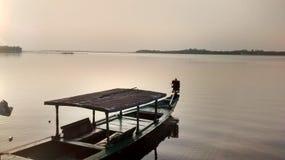 Barca del lago sun Immagine Stock