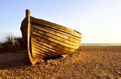 Barca del pescador en la puesta del sol Fotografía de archivo