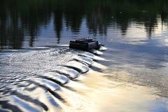 Barca dell'alimentatore dell'esca di pesca Immagini Stock Libere da Diritti