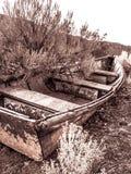 Barca di fila abbandonata Immagini Stock