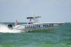 Barca di polizia della spiaggia Immagini Stock