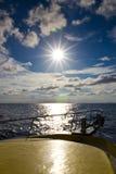 Barca e sole Fotografie Stock