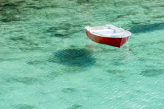 Barca floating in transparent water Royalty Free Stock Images
