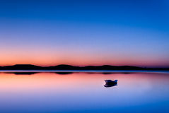 Barca nel tramonto Fotografie Stock
