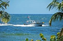 Barca pilota che ritorna alla porta Fotografia Stock