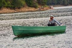 Barca a remi e barcaiolo Fotografia Stock