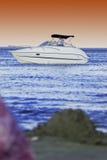 Barca su acqua Immagini Stock