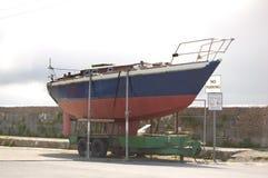 Barca sul pilastro Fotografia Stock