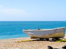 Barca sulla costa di mare Fotografie Stock